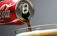 Coca-Cola bets big on small bottles, cans